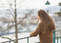 Happy young woman in winter park looking into distance with long hair Royalty Free Stock Photography