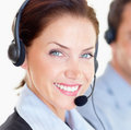 Happy young woman working at a call centre Stock Photo