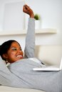 Happy young woman working on laptop Stock Photography