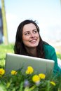 Happy young woman working on laptop outdoors Royalty Free Stock Photo
