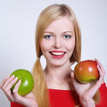 Happy young women with the fruits Stock Images