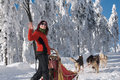 Happy young women-musher Royalty Free Stock Image