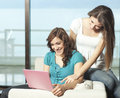 Happy young women with netbook Royalty Free Stock Image