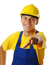 Happy young worker pointing at you and smile Royalty Free Stock Image