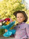 Happy youngster with bouquet of flowers Royalty Free Stock Image