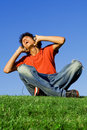 Happy youth listening music Royalty Free Stock Photos