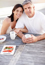 Happycouple having fruit salad and coffee together Royalty Free Stock Photography