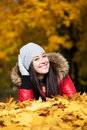 Happyl woman on a  autumn trees background Stock Photo