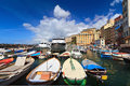 Harbor in camogli with fishing boats famous small town liguria italy Stock Images