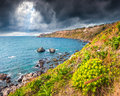 The harbor and cape Milazzo with nature reserve Piscina di Vener Royalty Free Stock Photo