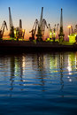 Harbor / Cargo / Silhouette of  Cranes at Sunset Royalty Free Stock Photo
