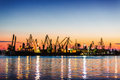 Harbor cranes in port and beautiful sunset Royalty Free Stock Photo