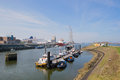 Harbor in dutch ijmuiden with boats at the coast Stock Photos