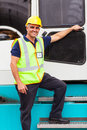 Harbor forklift driver senior standing on in container depot Royalty Free Stock Photo
