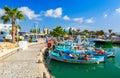 Harbor near Ayia Napa. Fishing boats, palms and tourists. Royalty Free Stock Photo