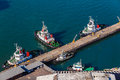 Harbor pilot tugs vessels mooring air photo colorful image overlooking a moored alongside the wharf in durban port city on the Royalty Free Stock Photos