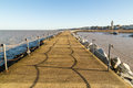 Harbor wall the walkway along the rock water break harbour in herne bay kent uk Stock Photos