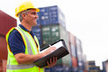 Harbor worker smiling middle aged at container depot Royalty Free Stock Images