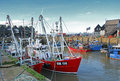 Harbour fishing boats photo of whitstable working with at quayside photo taken rd november and useful for working Stock Photo