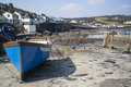 Harbour at low tide with fishing boats coverack england Stock Photography