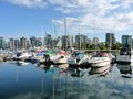 Harbour reflections on the quiet waters with city skyline Royalty Free Stock Photos