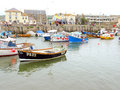 The harbour west bay dorset small harbor with boats from as far as cornwall at england uk Royalty Free Stock Images