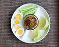 Hard boiled egg with thai food Stock Images