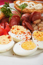 Hard boiled eggs chicken with beans and sausage served for breakfast Royalty Free Stock Photography