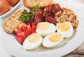 Hard boiled eggs hardboiled chicken with beans and sausage served for breakfast Stock Images