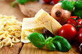 Hard cheese and pasta with fresh tomatoes Royalty Free Stock Photography
