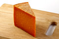 Hard cheese a wedge of red leicestershire on a wooden board Stock Photos