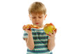 Hard choice little boy in striped t shirt making between pizza and apple Royalty Free Stock Photography
