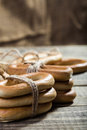 Hard cracknels bind with string photo eye level closeup groups of delicious oval in bunches and laying on wooden table on blurred Royalty Free Stock Images