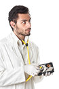 Hard disk control a doctor technician wearing a lab coat and stethoscope holding an Stock Photos