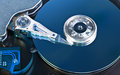 Hard disk drive opened toned in blue Royalty Free Stock Images