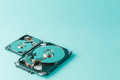Hard disk drives opened on a blue background