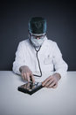 Hard disk healthcare doctor or technician wearing a lab coat and stethoscope examining an Royalty Free Stock Photos