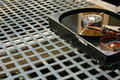 Hard disk on a metal grid Royalty Free Stock Images