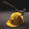 Hard hat accident at work a hammer stuck in the helmet Royalty Free Stock Photos
