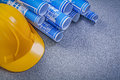 Hard hat blue construction drawings on grey background Royalty Free Stock Photo