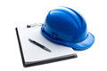 Hard hat with clipboard on white background Royalty Free Stock Photography