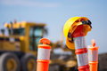 Hard hat on road highway construction pylon hats safety pylons Stock Photos