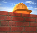 Hard hat wall protective helmet on a brick your text or logo on the Royalty Free Stock Photos