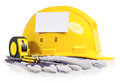 Hard hat yellow with work gloves and tools including screwdriver and a tape measure on a white background Royalty Free Stock Photo