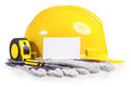 Hard hat yellow with work gloves and tools including screwdriver and a tape measure on a white background Royalty Free Stock Images