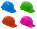 Hard hats hat with path isolated on a white background in four colors blue green red and pink Stock Images