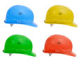 Hard hats hat with path isolated on a white background in four colors blue yellow green and red Stock Images
