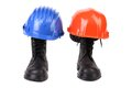 Hard hats and working boots on a white background Royalty Free Stock Photo