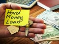 Hard money loan sign and key from home Royalty Free Stock Photo