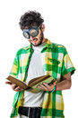 Hard reading a guy wearing casual clothes and on old pair of goggles over a white bachground and an old book Stock Photography